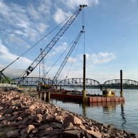 Crews cleaning up barges from first drilled shaft pour_5.21.21