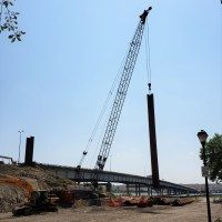 Crane lifting sheet piling to place for temporary shoring_7.21.21