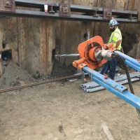 Screwing in tie backs along temporary shoring2_9.11.21