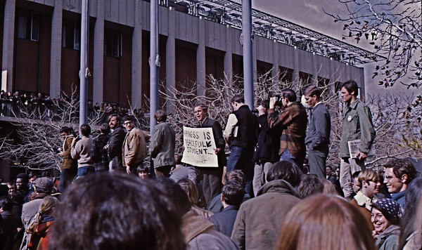 """4*Fri, Jan 31, 1969*People: Holy Hubert, crowdSubject: *Place: entrance to Sproul PlazaActivity: TWLF protestComments: """"HAPPINESS IS A PEACFULL STUDENT""""  -- also, happiness is cops off campus!"""