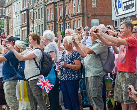 Crowds photographing the Olympic Torch relay in Cromer, North Norfolk