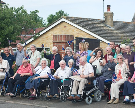 Olympic Torch relay in Cromer, North Norfolk - old age pensioners outside Halsey House