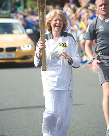 Nicky Wardale carrying the Flame during the Olympic Torch relay in Cromer, North Norfolk