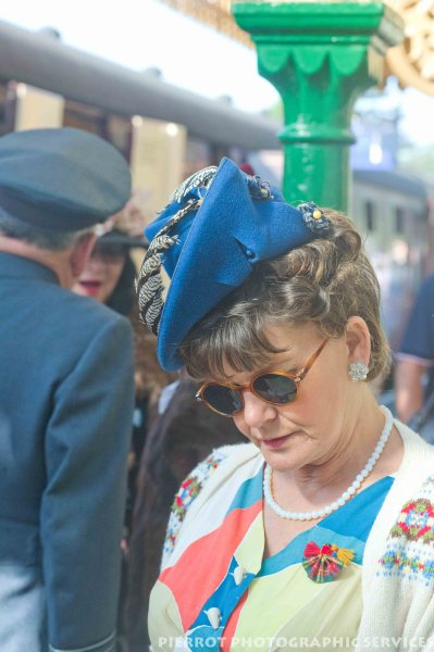 Woman wearing period hat at 1940s weekend in Sheringham