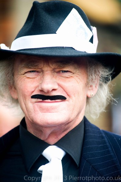 Spiv with fake moustache