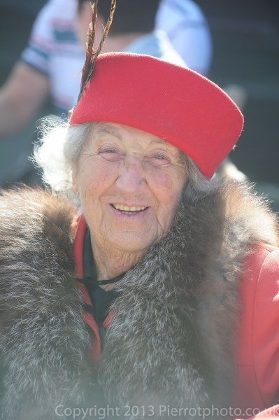 Older lady with red hat