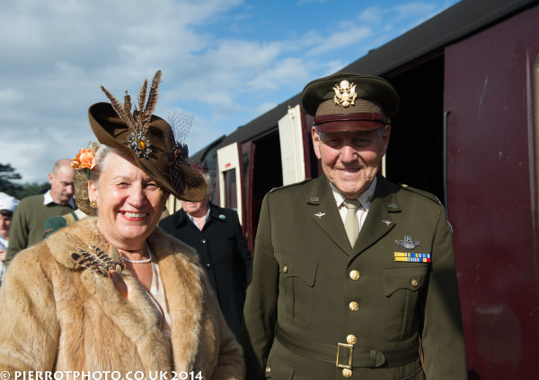 1940s weekend in Sheringham North Norfolk 2014 - lady with feathered hat and fur coat with officer in uniform