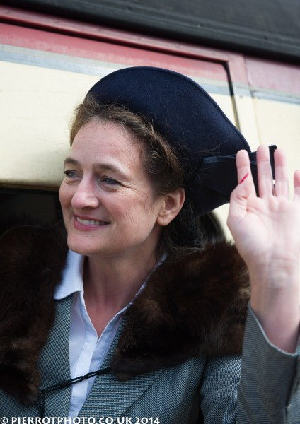 1940s weekend in Sheringham North Norfolk 2014 - attractive woman with blue hat waving goodbye from train