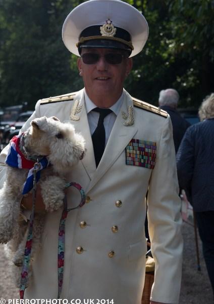 1940s weekend in Sheringham North Norfolk 2014 - naval officer carrying dog