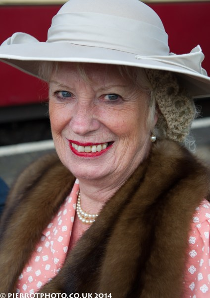 1940s weekend in Sheringham North Norfolk 2014 - woman in beige hat