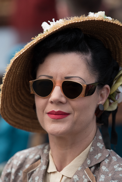 1940s weekend in Sheringham North Norfolk 2017. Woman with dark glasses and large straw hat.