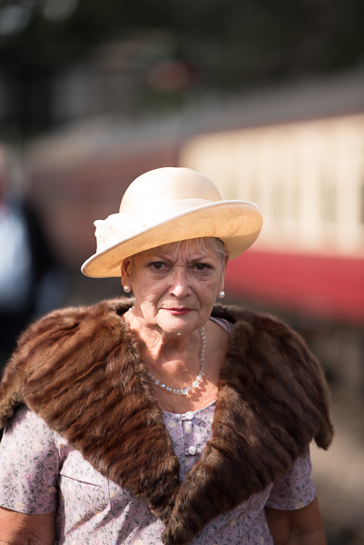 1940s weekend in Sheringham North Norfolk 2017. Mature woman with fur stole and cream hat.