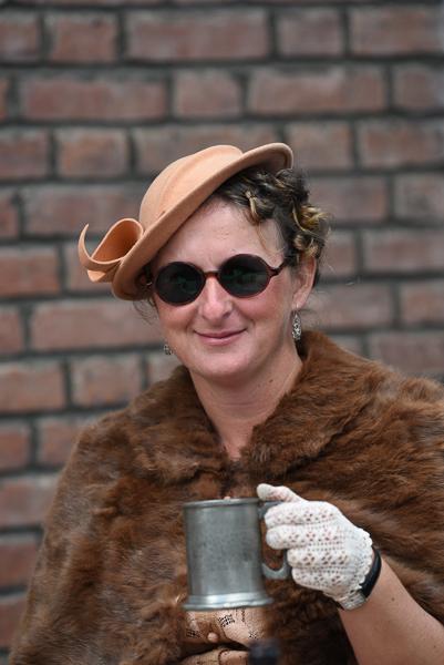 1940s weekend in Sheringham North Norfolk 2017. Lady in fur stole holding pewter tankard