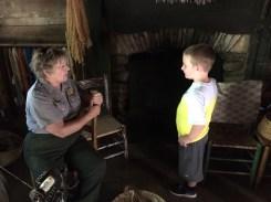 Isaiah with a Park Ranger at Mabry Mill