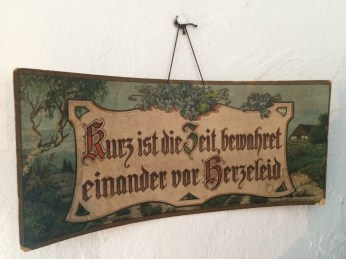 """Hanging in the dining room of the communal kitchen museum in Middle Amana: """"Time is short, [so] keep one another from sorrow"""""""