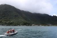 Small boat heads into Pago Pago, American Samoa, NOAA Photo by Ray Boland.