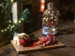 Charcuterie Board / gourmet European cured meats, aged white cheddar cheese, gherkins, fruit, and nuts / $15