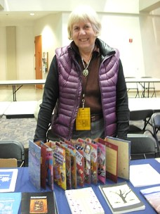 Book artist and poet Marilyn Stablein at her booth in the Small Press Fair. (Photo © Kim Goldberg)