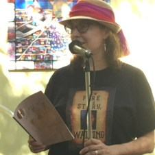 photo of Maria Kelson reading a book