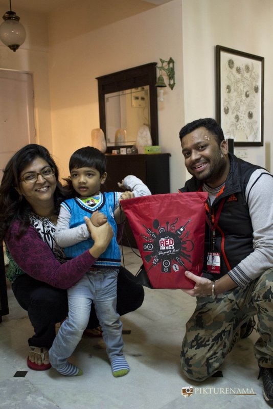 Rj Dev handing over the bag of goodies to excited Tugga