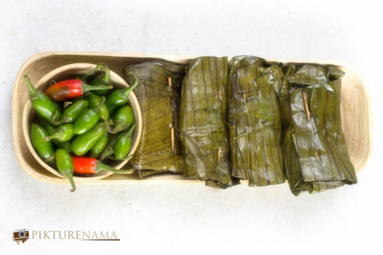 Ilish Paturi and some green chillies