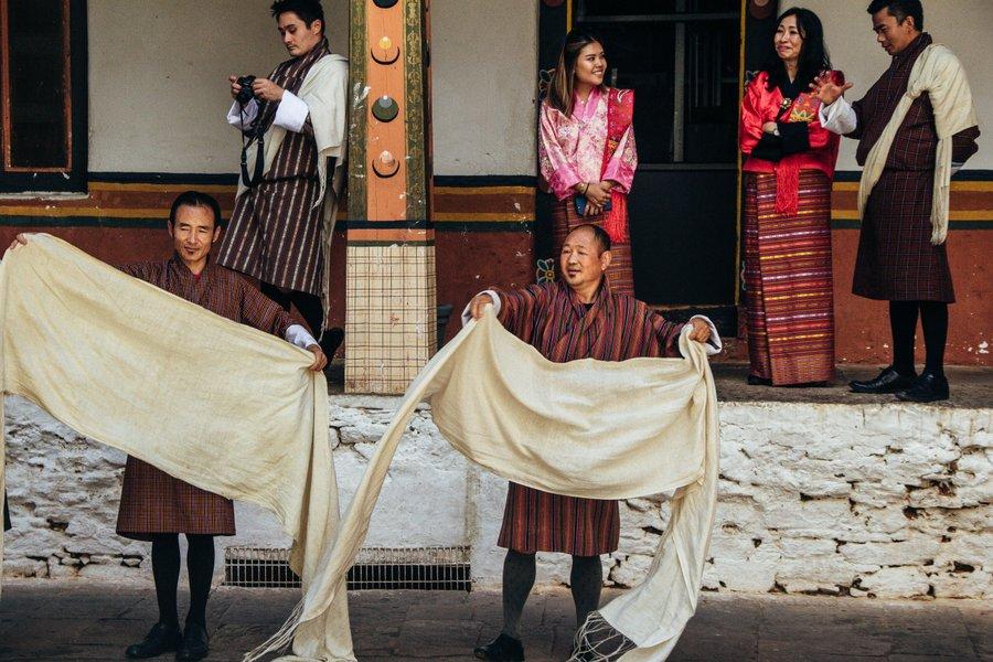 Inside Punakha Dzong when a class was going on how to offer Khadar