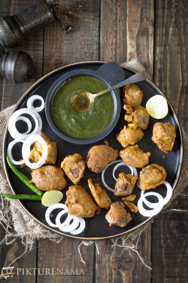 snacking on Spicy Mutton Pakoda - 4