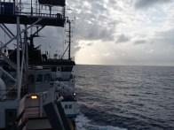 Sunrise over the Atlantic Ocean. R/V Marcus G. Langseth sailing through calm seas.