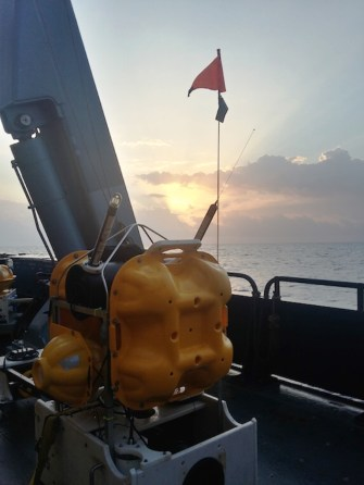 Ocean Bottom Seismometer waiting for its deployment sometime after sunset.