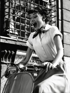 Audrey Hepburn in Roman Holiday on a scooter