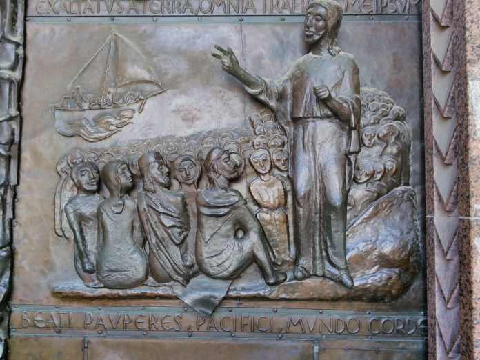Jesus and disciples on the sea on door of basilica