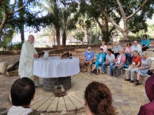 From. Joe celebrating liturgy with the Lake in the background