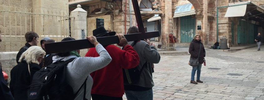 Pilgrims carry the Cross along the Via Dolorosa in Jerusalem - January 2017