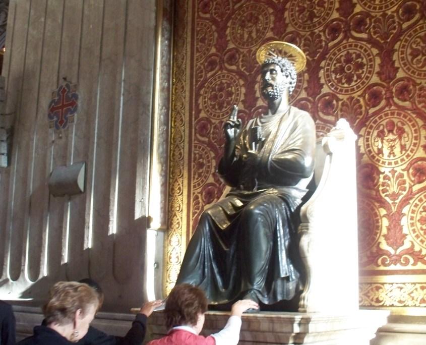 Pilgrims venerate the statue of Saint Peter at his Basilica in Rome