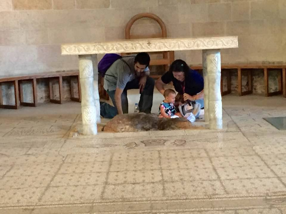 Pilgrim couple with their daughter at Tabgha