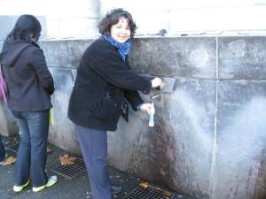 Gloria getting water at the Lourdes grotto
