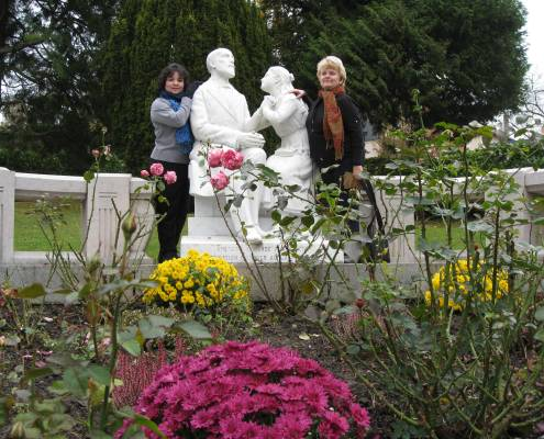 Gloria and fellow pilgrim Susie, at the home of St. Therese in Lisieux