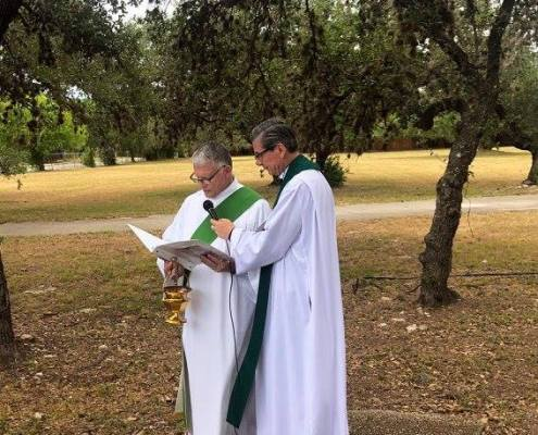 Archbishop and Deacon Tom Fox lead the blessing of land