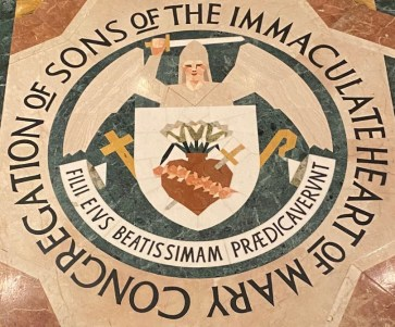 Floor with seal of the Claretian fathers.