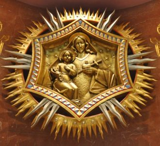 Close Up of wooden medallion above the altar.