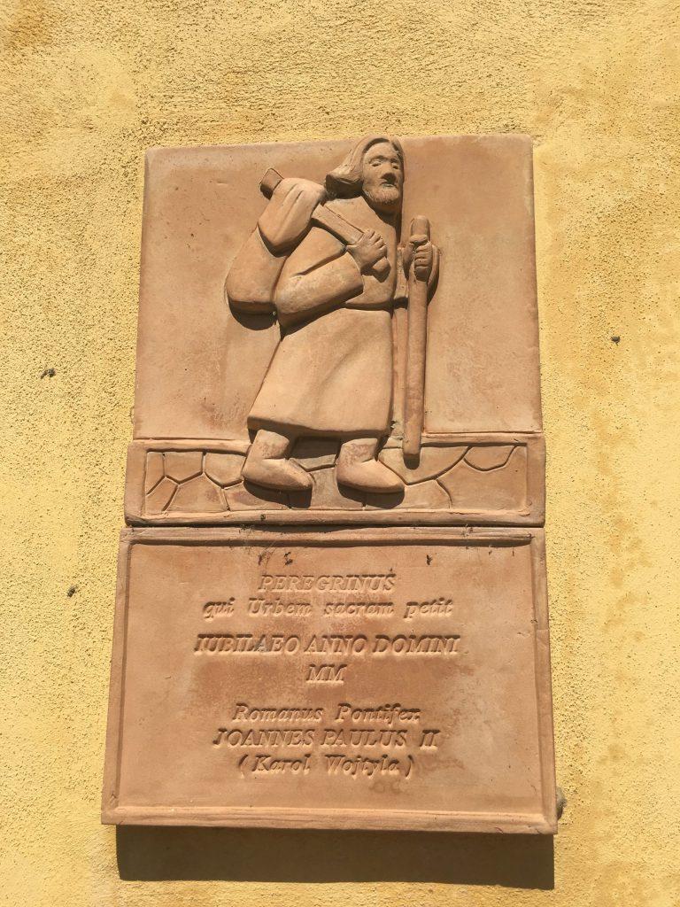 Pilgrim plaque in Corte San Andrea, commemorating Pope John Paul II