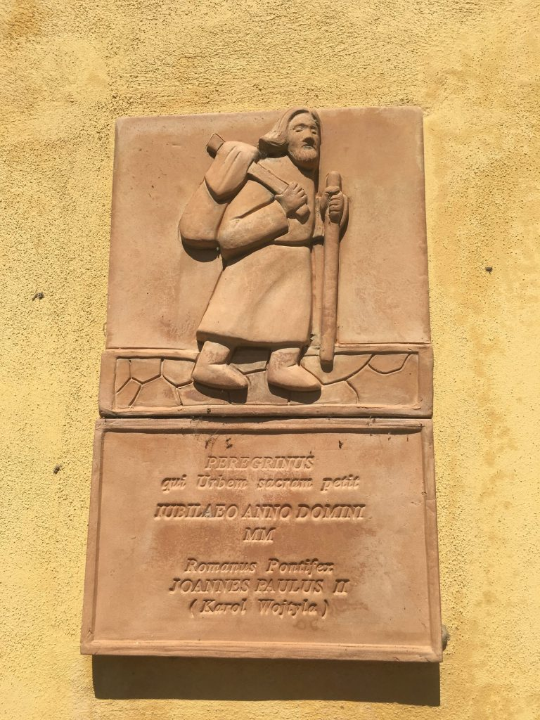 Pilgrim plaque in Corte San Andrea, commemorating Pope John Paul II