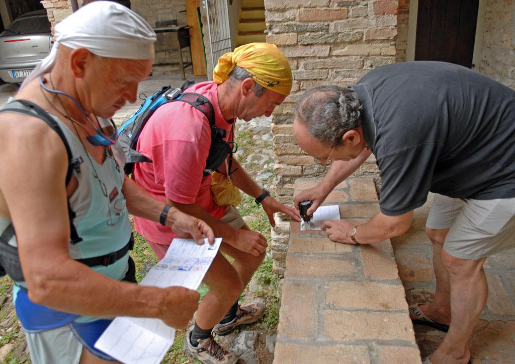 Svizzano - pilgrims having passports stamped