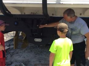 Ryan, Ronan and Randy inspecting the boat maintenance