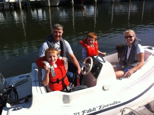 Family ride in the dinghy, Tarpon Springs, FL