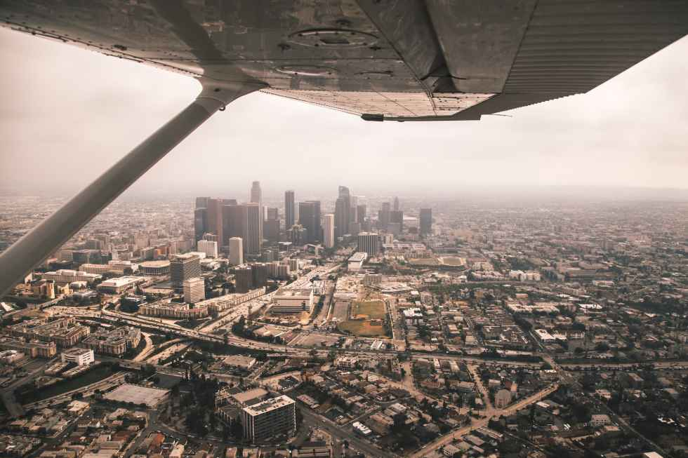 view on down town Los Angeles from the wing of our Cessna 172