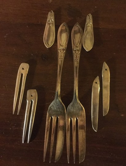 Two appetizer forks, three pair of earrings