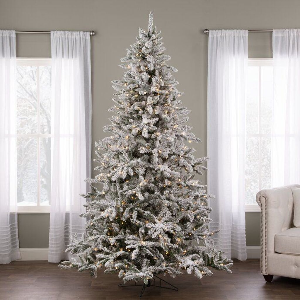 Stunning White Christmas Tree Ideas To Decorate Your Interior 29