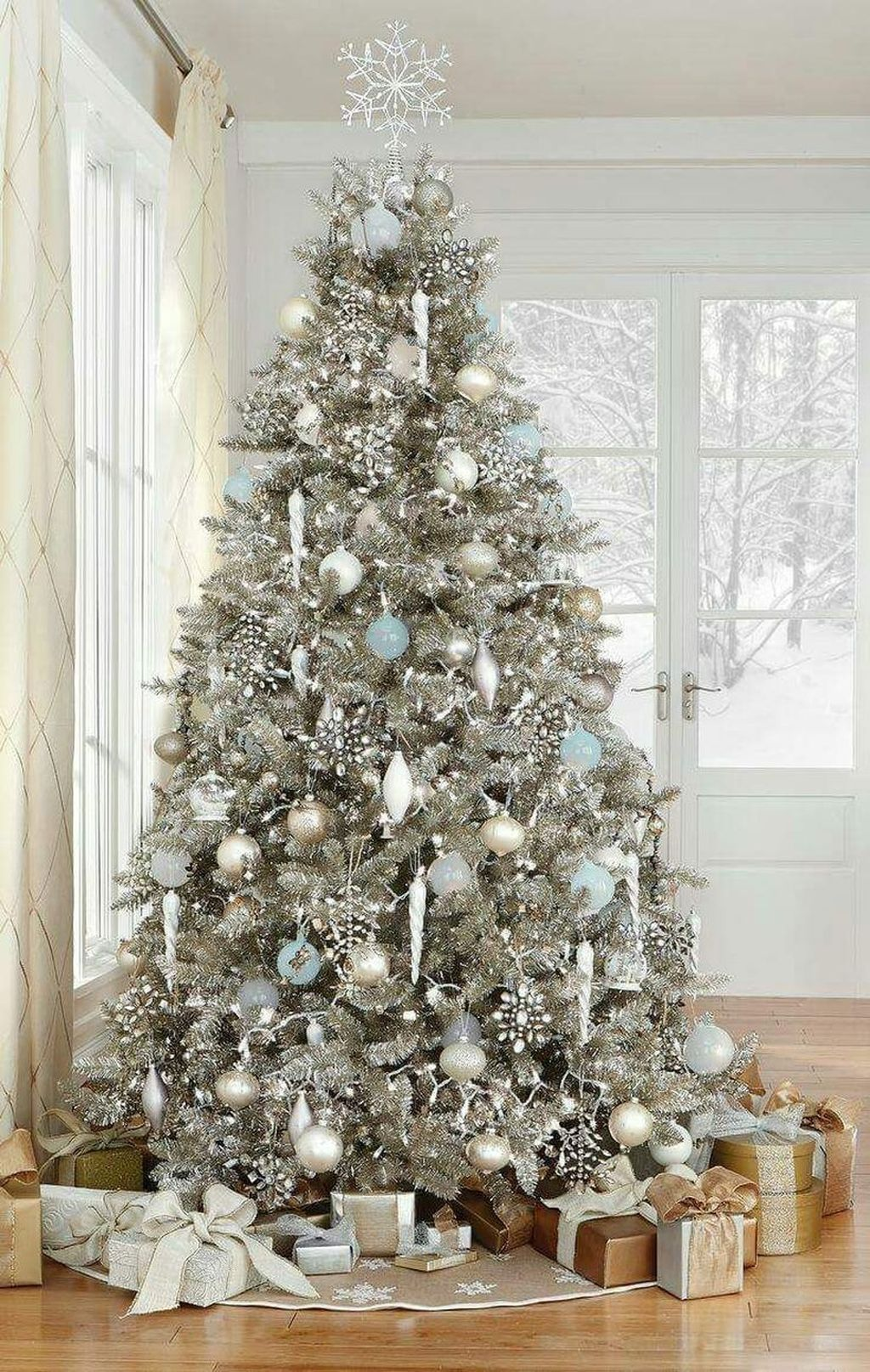 Stunning White Christmas Tree Ideas To Decorate Your Interior 34