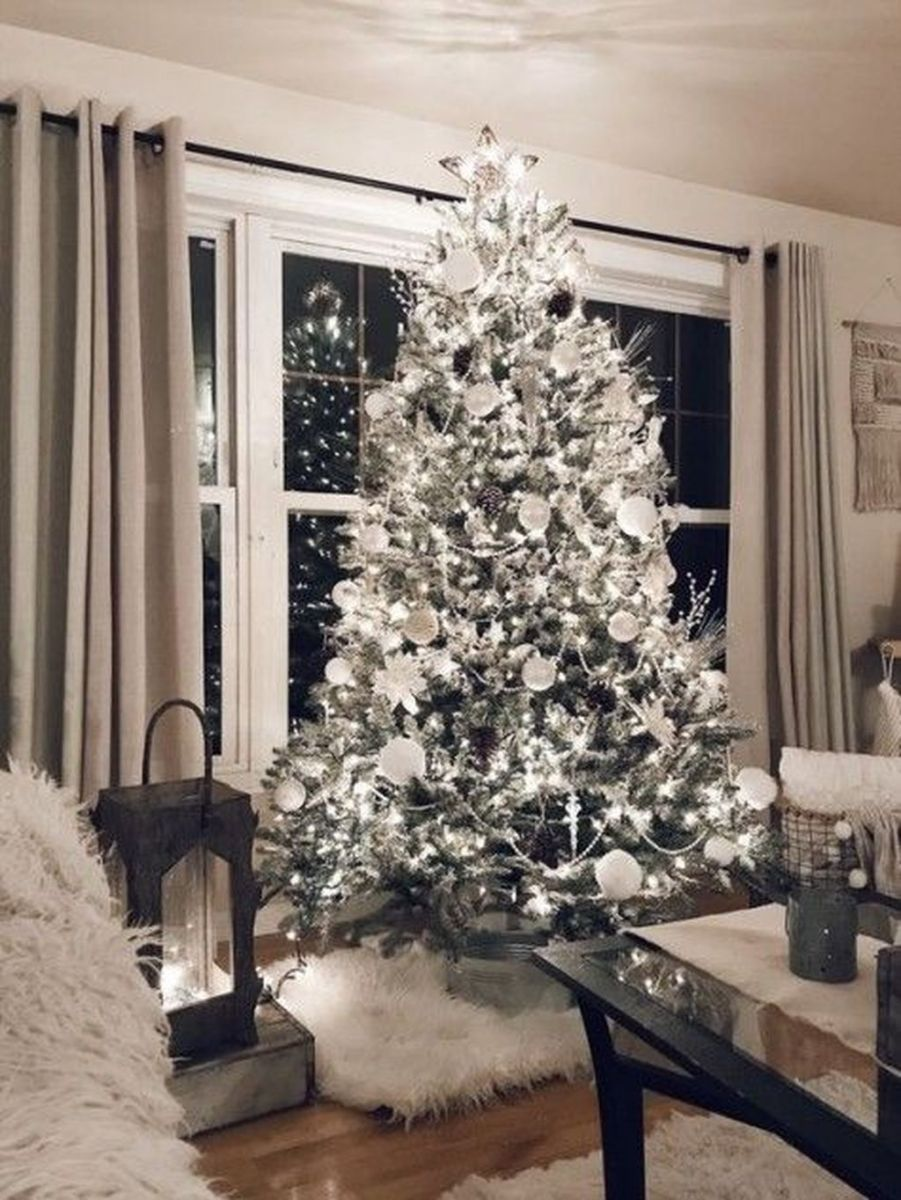 Stunning White Christmas Tree Ideas To Decorate Your Interior 35